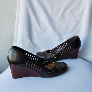 BCBGirls Brown Wedge Leather Shoes in a size 9.5